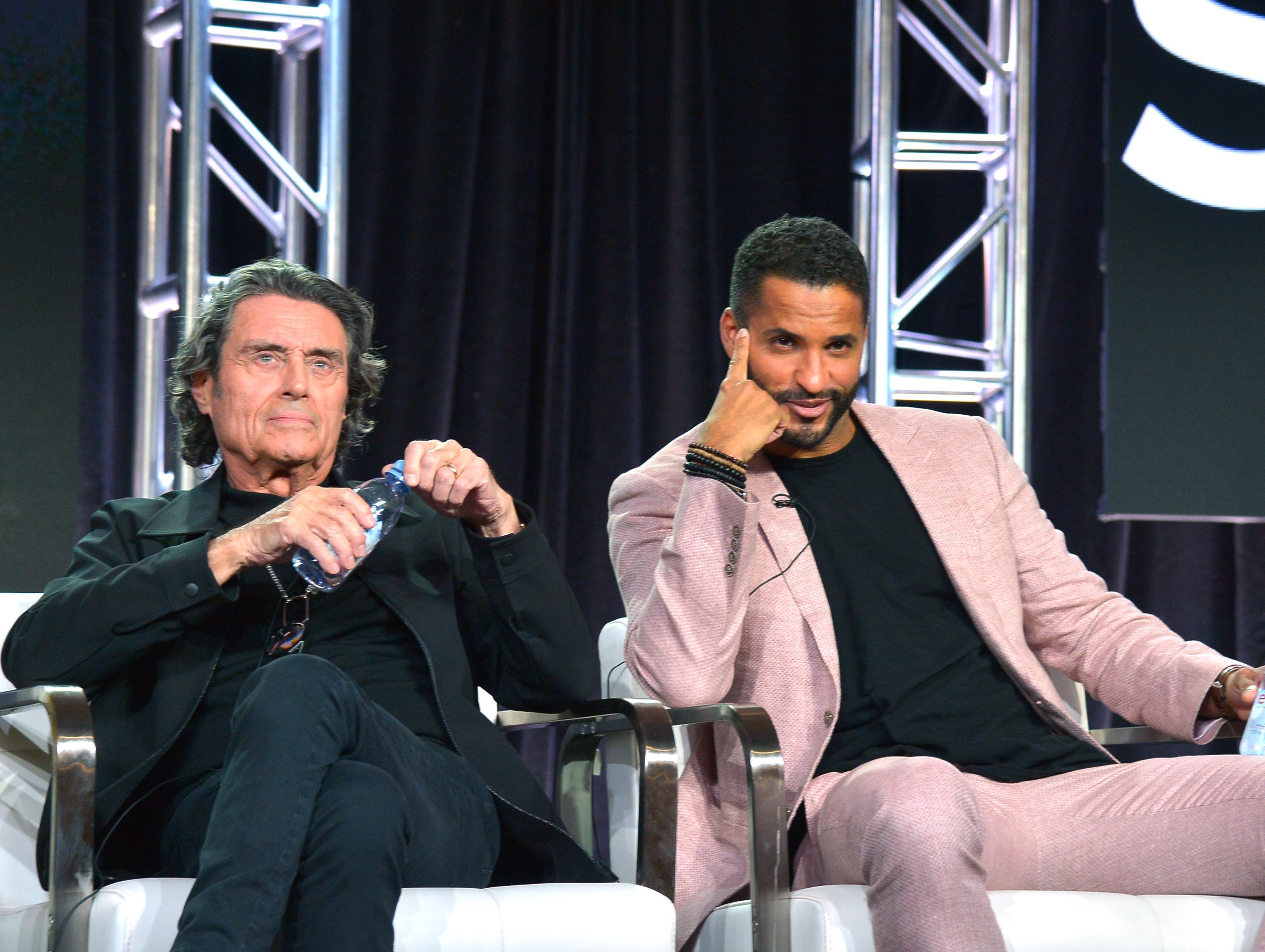 """Ian McShane and Ricky Whittle take questions during Starz's """"American Gods"""" panel."""