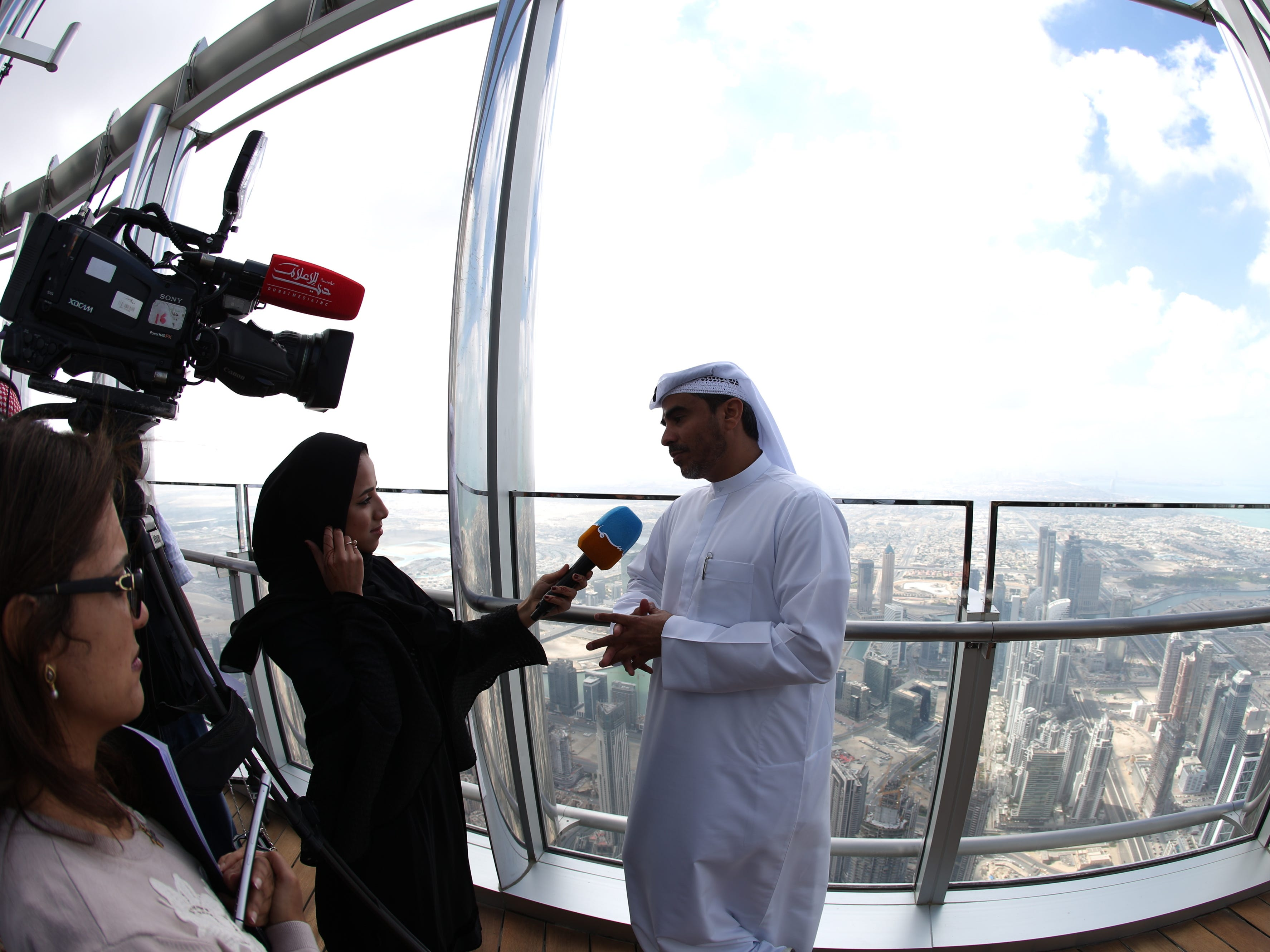 epa07366408 A picture taken with a fish eye lens shows Ahmad Al Falasi, Executive Director Emaar Properties talking to media at the new highest lounge in the world at Burj Khalifa in Dubai, United Arab Emirates, 13 February 2019. Ahmad Al Falasi, Executive Director Emaar Properties announced during media briefing the opening of highest lounge in the world at Burj Khalifa which is located at 152, 153 and 154 floor which have distinctive settings each assuring never before seen views of the city.  EPA-EFE/ALI HAIDER ORG XMIT: XAH001