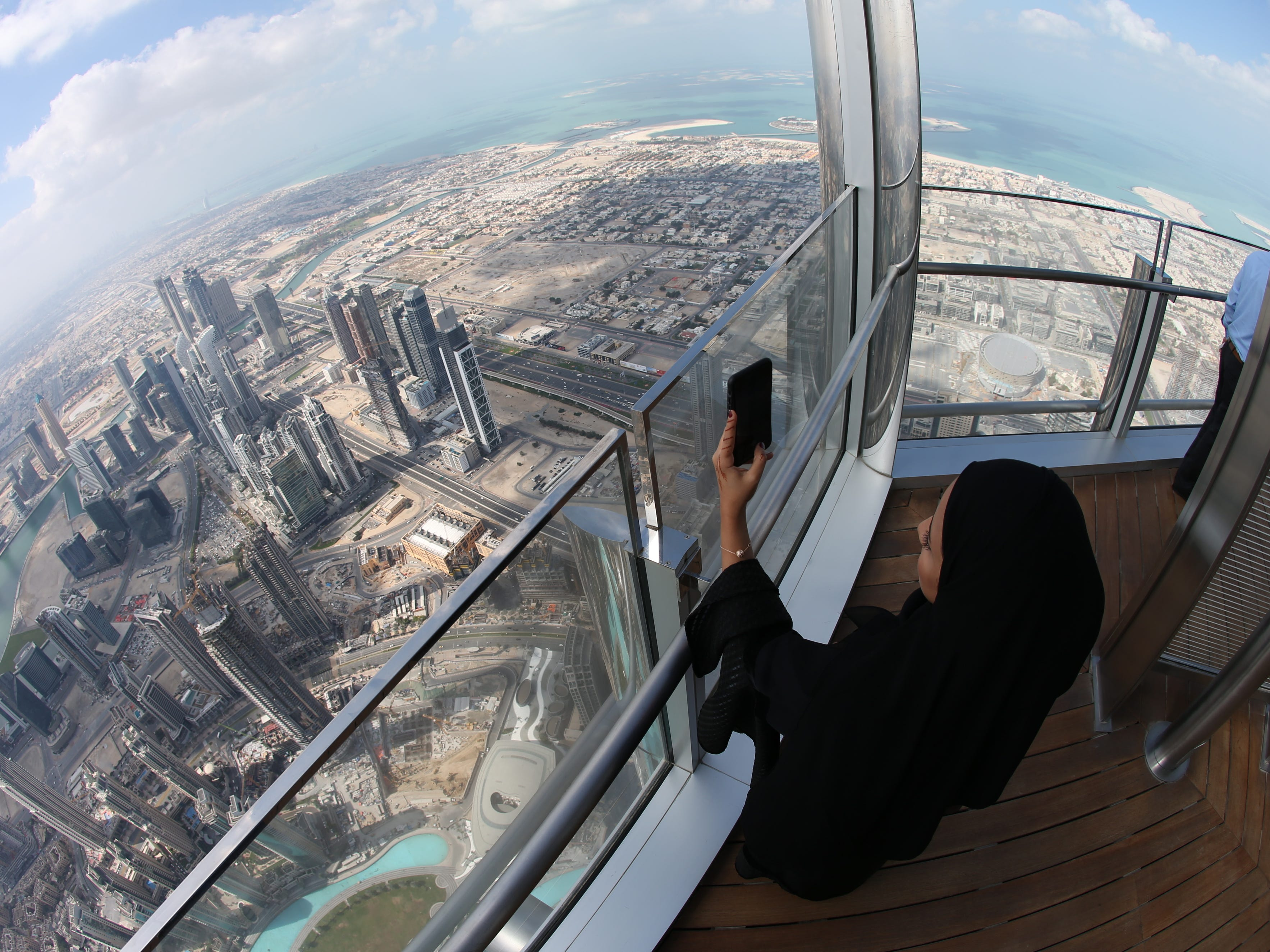 epa07366680 A picture taken with a fish eye lens shows people inspecting the new highest lounge in the world at Burj Khalifa in Dubai, United Arab Emirates, 13 February 2019. Ahmad Al Falasi, Executive Director Emaar Properties announced during media briefing the opening of highest lounge in the world at Burj Khalifa which is located at 152, 153 and 154 floor which have distinctive settings each assuring never before seen views of the city.  EPA-EFE/ALI HAIDER ORG XMIT: XAH001