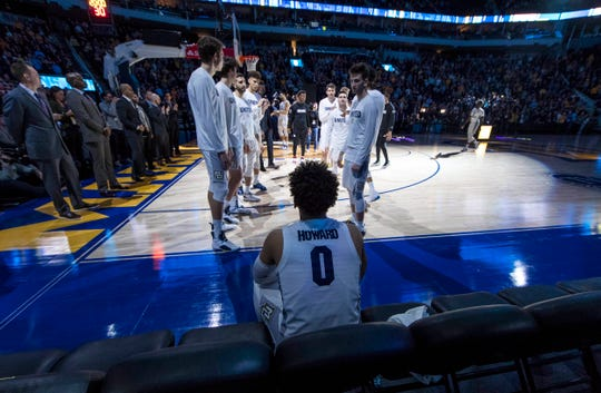 Marquette Golden Eagles guard Markus Howard (0) sits on the bench before being announced to the crowd prior to the game against the St. John's Red Storm at Fiserv Forum.