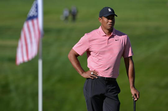 Tiger Woods looks on from the 13th green during the final round of the Farmers Insurance Open golf tournament at Torrey Pines Municipal Golf Course - South Course.