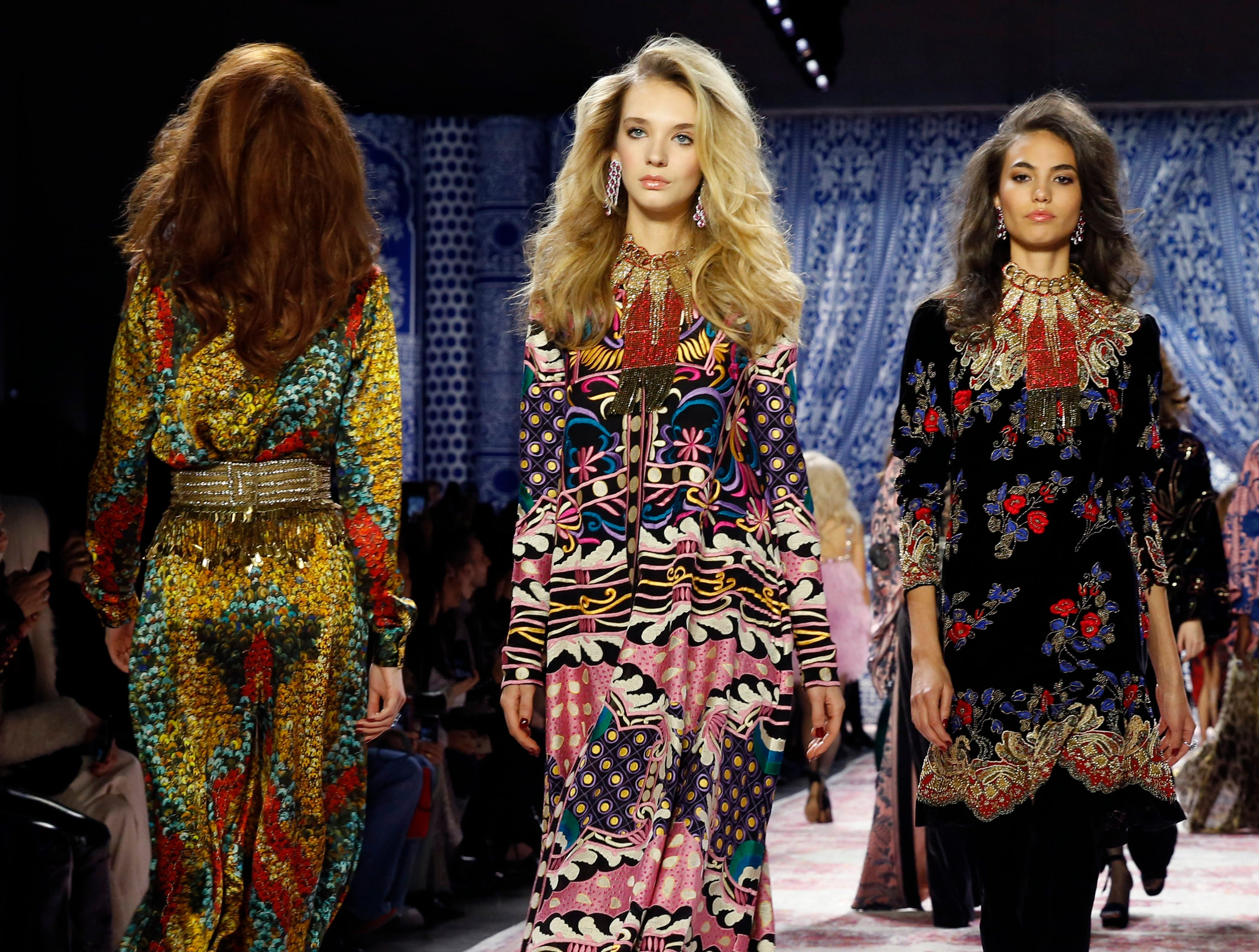 The latest fashion creations from Naeem Khan are modeled during New York Fashion Week, Tuesday, Feb. 12, 2019, in New York. (AP Photo/Kathy Willens) ORG XMIT: OTKKW109