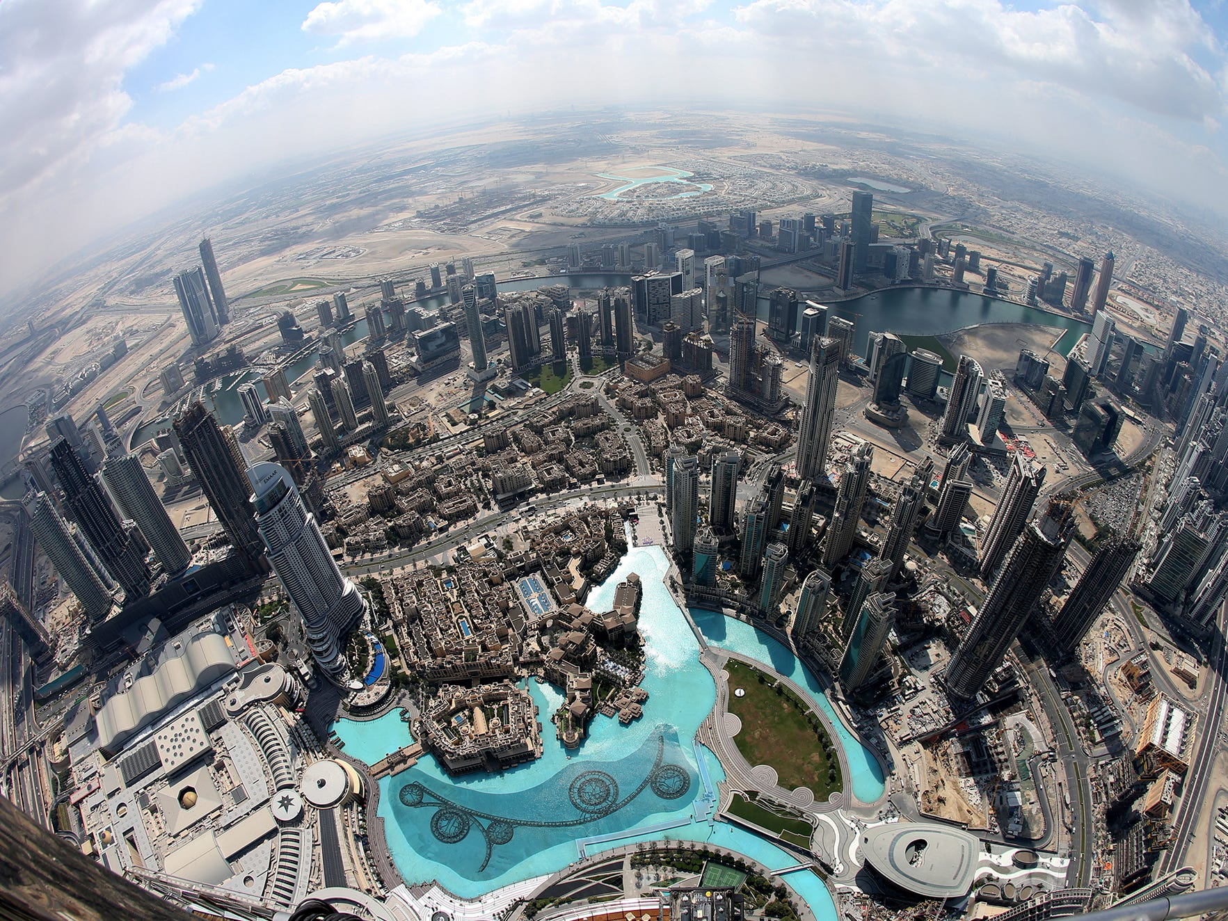 epa07367641 A picture taken with a fisheye lens shows areas close to the world's tallest building Burj Khalifa as seen from the the new highest lounge in the world at Burj Khalifa in Dubai, United Arab Emirates, 13 February 2019. Ahmad Al Falasi, Executive Director Emaar Properties announced during media briefing the opening of highest lounge in the world at Burj Khalifa located on the 152, 153, and 154 floors at 575 metres, with each have its distinctive settings assuring never before seen views of the city.  EPA-EFE/ALI HAIDER ORG XMIT: XAH051