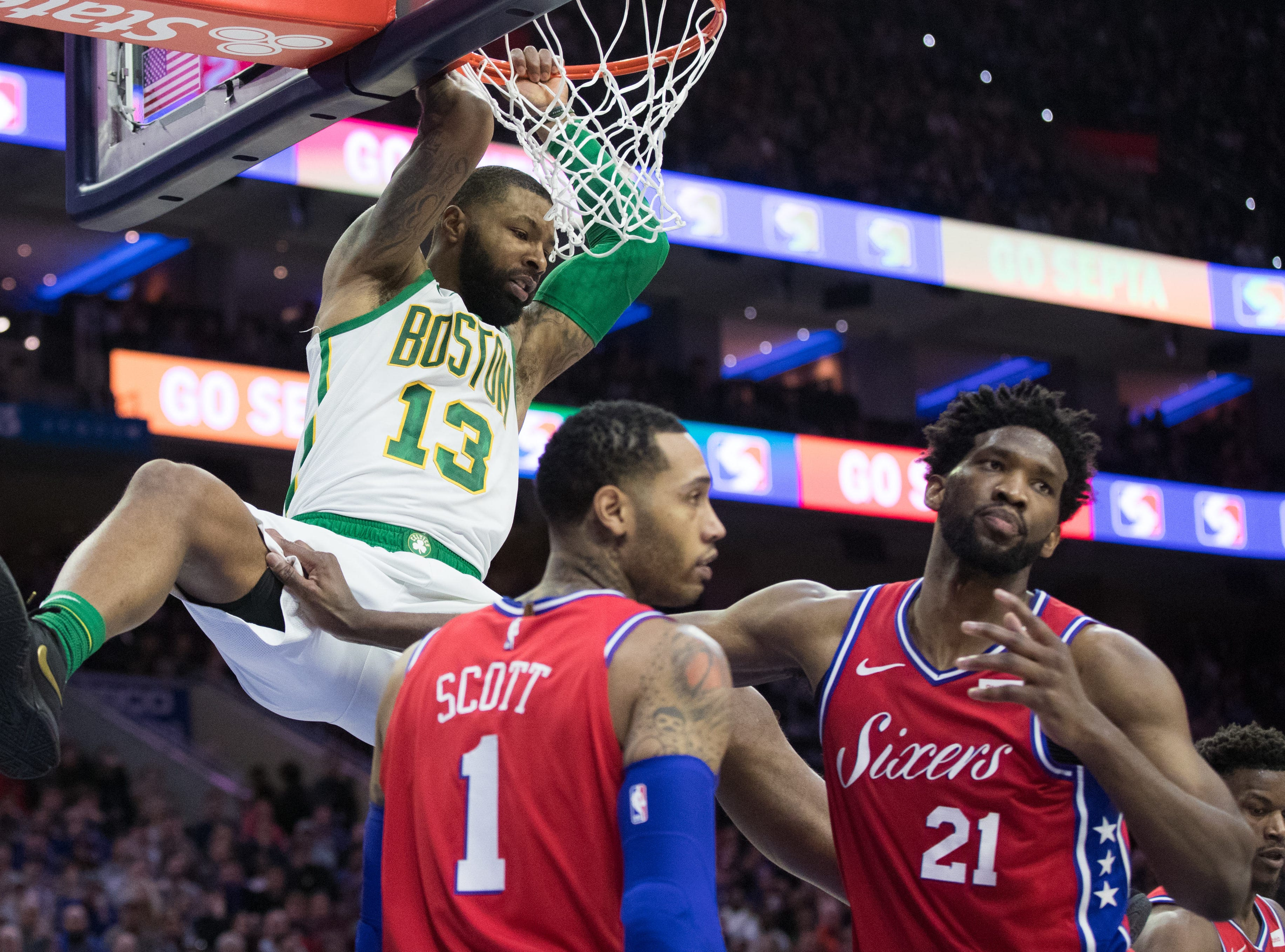 Feb. 12: Philadelphia 76ers center Joel Embiid (21) and forward Mike Scott (1) react as Boston Celtics forward Marcus Morris (13) hangs on the rim after a dunk in the fourth quarter at Wells Fargo Center.