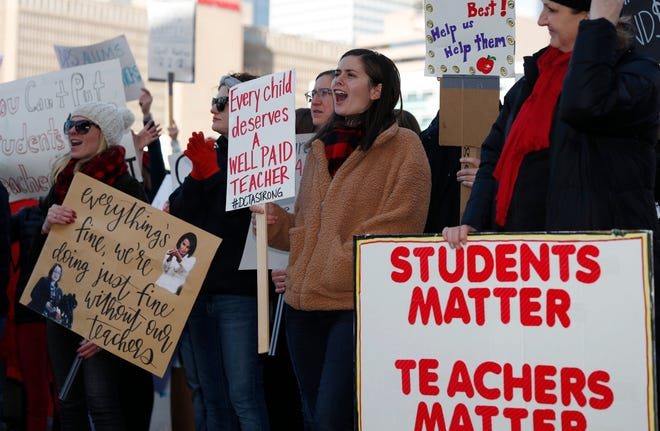 Liz Myers, center, a teacher at High Tech Elementary School, joins a chant during a rally for striking Denver Public Schools instructors in Civic Center Park.