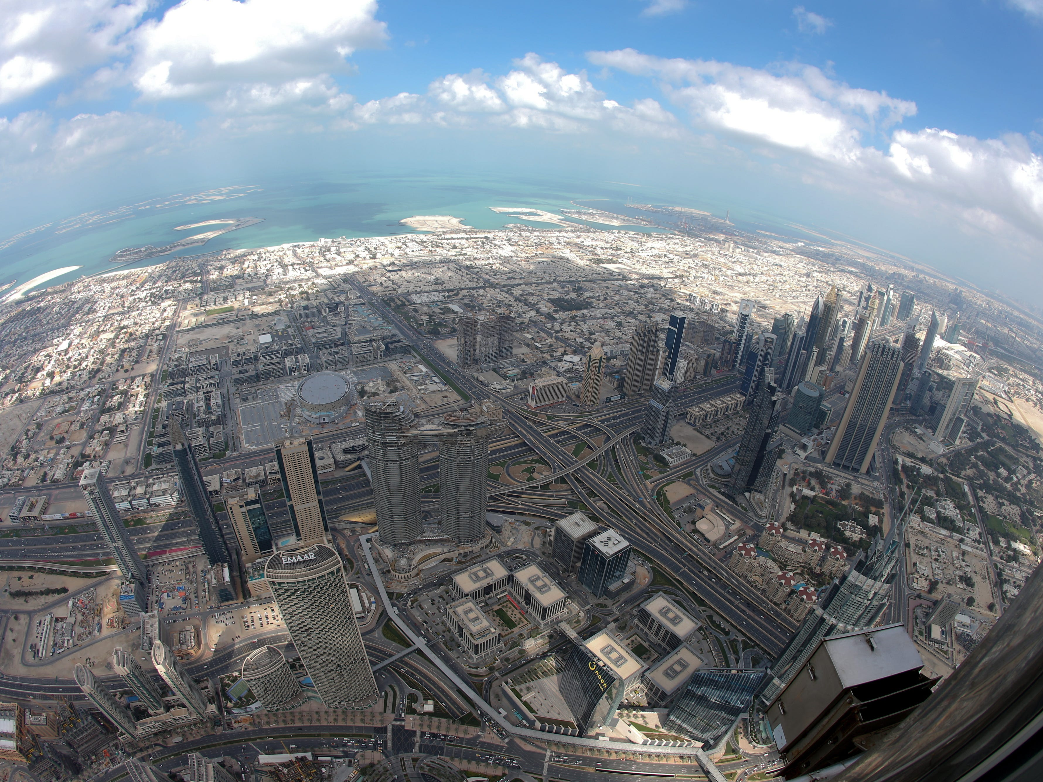 epa07367626 A picture taken with a fisheye lens shows areas close to the world's tallest building Burj Khalifa as seen from the the new highest lounge in the world at Burj Khalifa in Dubai, United Arab Emirates, 13 February 2019. Ahmad Al Falasi, Executive Director Emaar Properties announced during media briefing the opening of highest lounge in the world at Burj Khalifa located on the 152, 153, and 154 floors at 575 metres, with each have its distinctive settings assuring never before seen views of the city.  EPA-EFE/ALI HAIDER ORG XMIT: XAH051