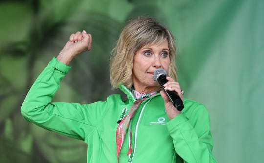 Olivia Newton-John speaks on stage during the annual Wellness Walk and Research Run on September 16.