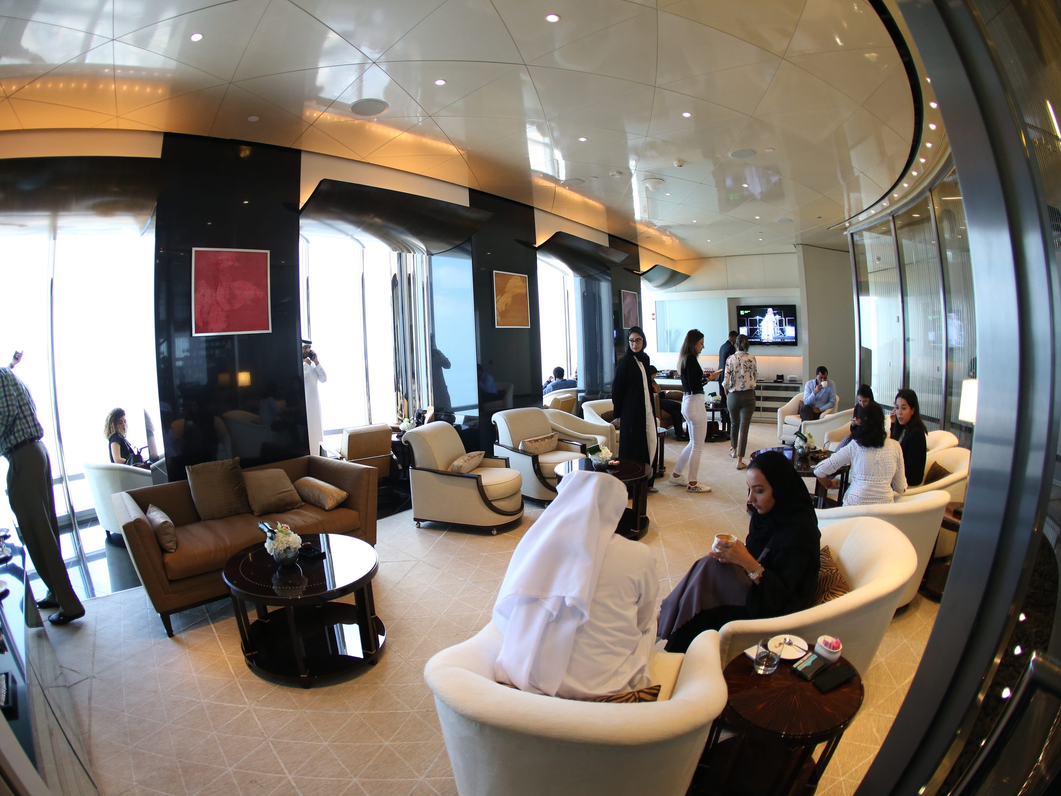 epa07366407 A picture taken with a fish eye lens shows people enjoying at the new highest lounge in the world at Burj Khalifa in Dubai, United Arab Emirates, 13 February 2019. Ahmad Al Falasi, Executive Director Emaar Properties announced during media briefing the opening of highest lounge in the world at Burj Khalifa which is located at 152, 153 and 154 floor which have distinctive settings each assuring never before seen views of the city.  EPA-EFE/ALI HAIDER ORG XMIT: XAH001