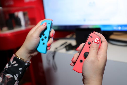 The Bluetooth Joy-Con controllers that come with your Nintendo Switch can work with PC and Mac games, too. Here a guest plays 'Mario Kart 8 Deluxe' at a special preview event in New York on Jan. 13, 2017.