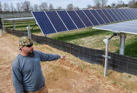 Jeremy Christ, electrical foreman for Southern Current solar  power company, looking over some of the 3,000 panels in a field along S.C. Highway 8 in Pelzer Thursday, February 14, 2019.
