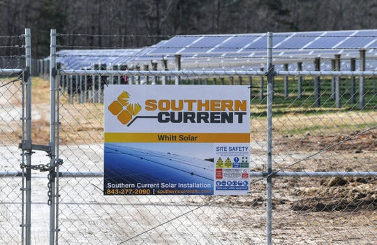 This is one of several warning signs on a fence surrounding Southern Current's Whitt solar farm in Anderson County on Thursday, Feb. 14, 2019.