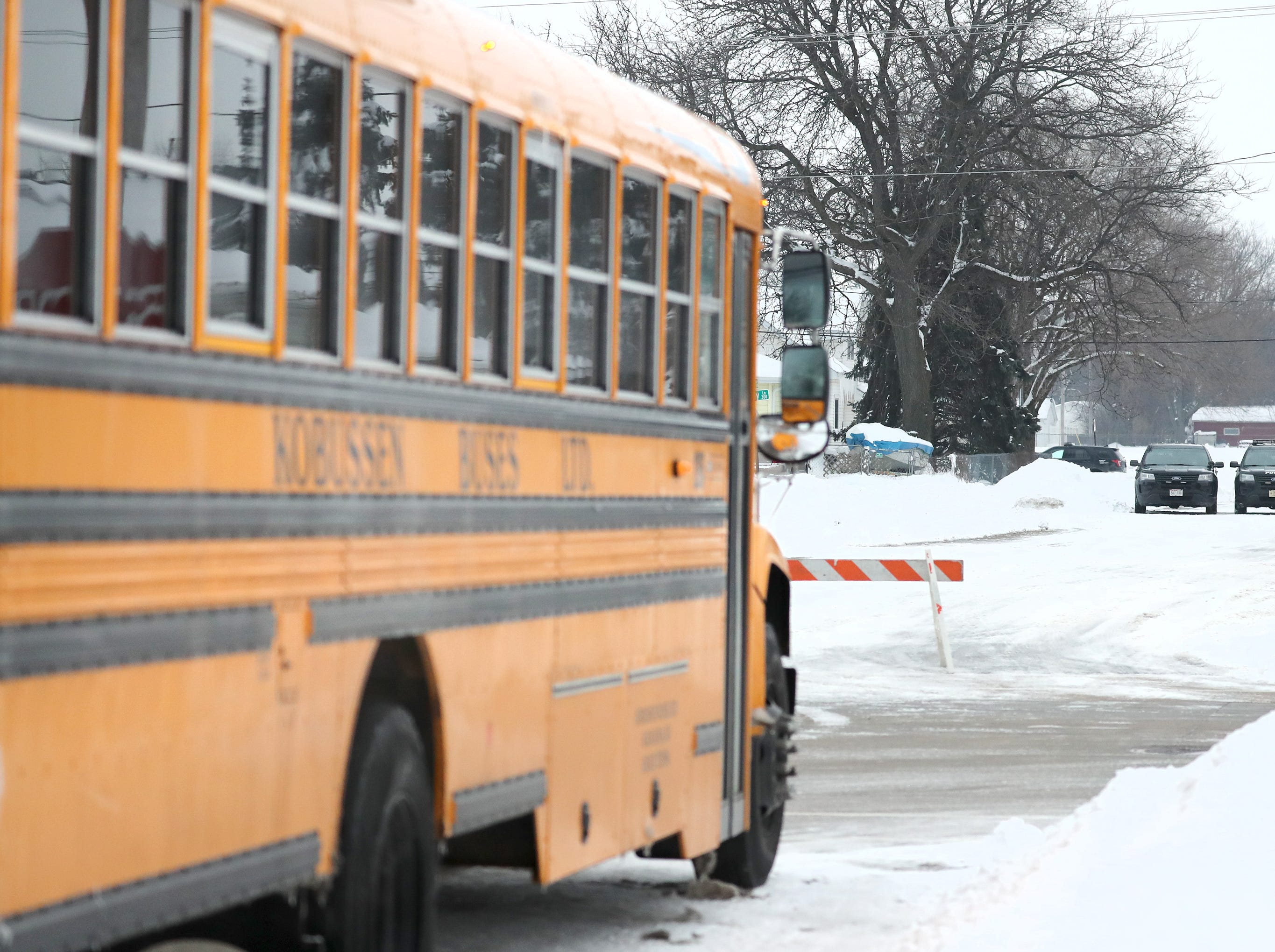 A Kobussen school bus is parked near the scene of an active police incident involving an armed man who barricaded himself inside a home on the 400 block of Quarry Lane Thursday, Feb. 14, 2019, in Neenah, Wis. Stuart Zuehls, a police officer and spokesman for the Neenah Police Department, said the department used a Kobussen bus to evacuate any nearby residents that wanted to be moved.Danny Damiani/USA TODAY NETWORK-Wisconsin