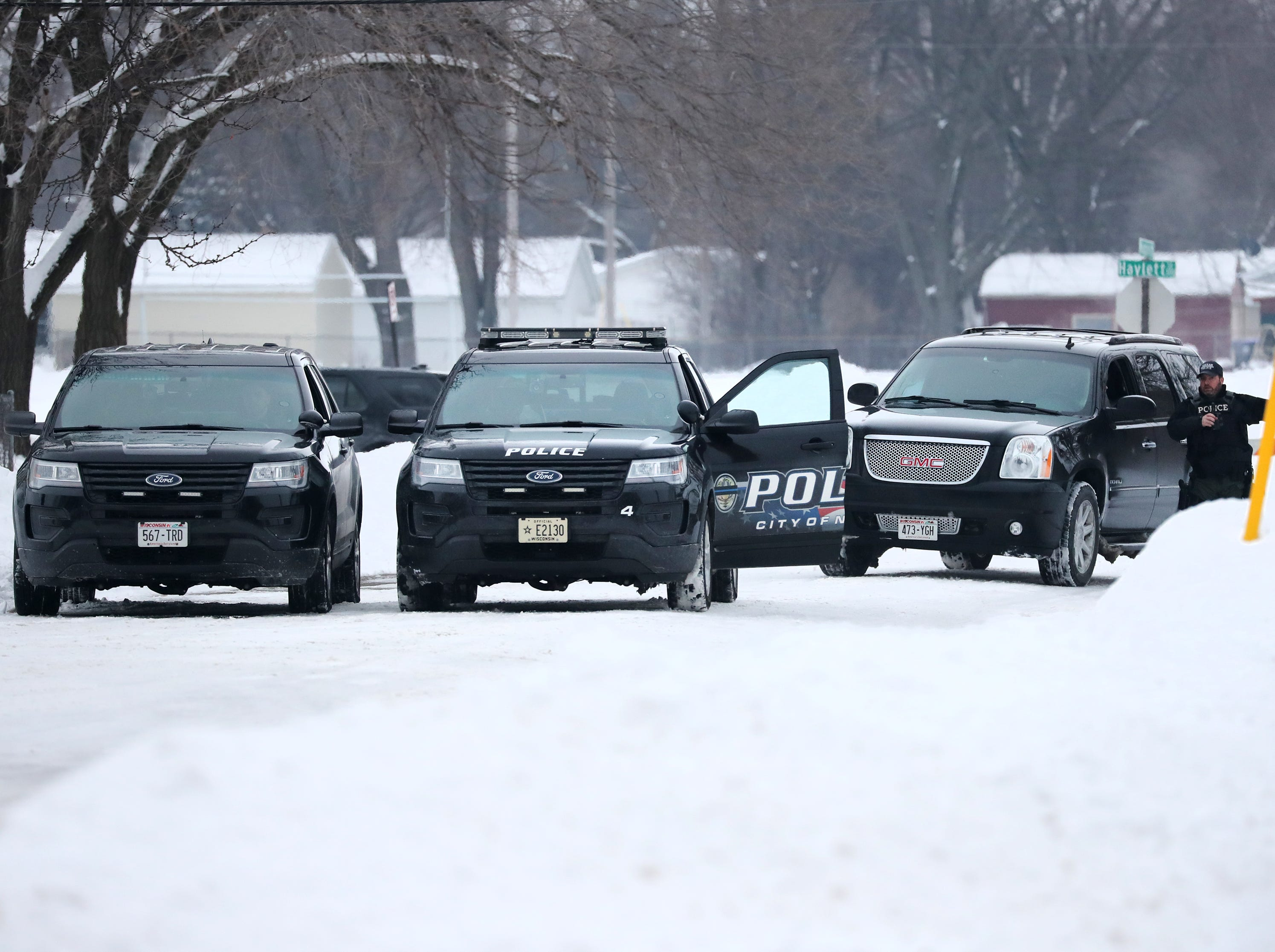 A Neenah police officer directs a vehicle during an active police incident involving an armed man who barricaded himself inside a home on the 400 block of Quarry Lane Thursday, Feb. 14, 2019, in Neenah, Wis.Danny Damiani/USA TODAY NETWORK-Wisconsin