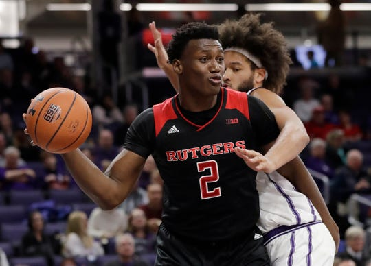 Rutgers center Shaquille Doorson, left, looks to pass as Northwestern center Barret Benson defends during the first half of an NCAA college basketball game, Wednesday, Feb. 13, 2019, in Evanston, Ill.