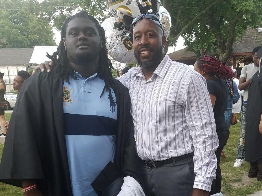 Braeden Bradforth (left) with football coach Tarig Holman at the Neptune High School graduation in 2018.