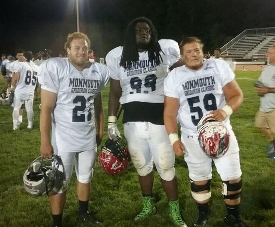 Neptune's Braeden Bradforth (center) poses with teammates after the 2018 Gridiron Classic All-Star Game.