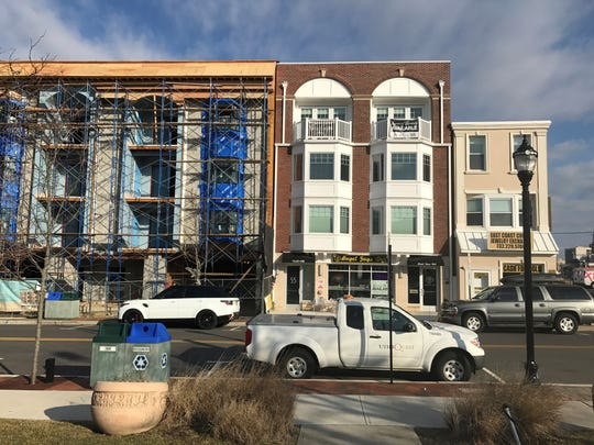 New construction in Long Branch's West End as seen on Feb. 14, 2019. The building on the left is owned by Martin Grubman. The adjacent building with the red brick facade is owned by West End Group. The buildings are located where a fire ripped through the West End on Feb. 13, 2012.