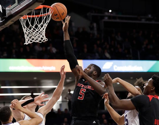 Rutgers forward Eugene Omoruyi (5) shoots against Northwestern during the first half of an NCAA college basketball game, Wednesday, Feb. 13, 2019, in Evanston, Ill. (AP Photo/Nam Y. Huh)