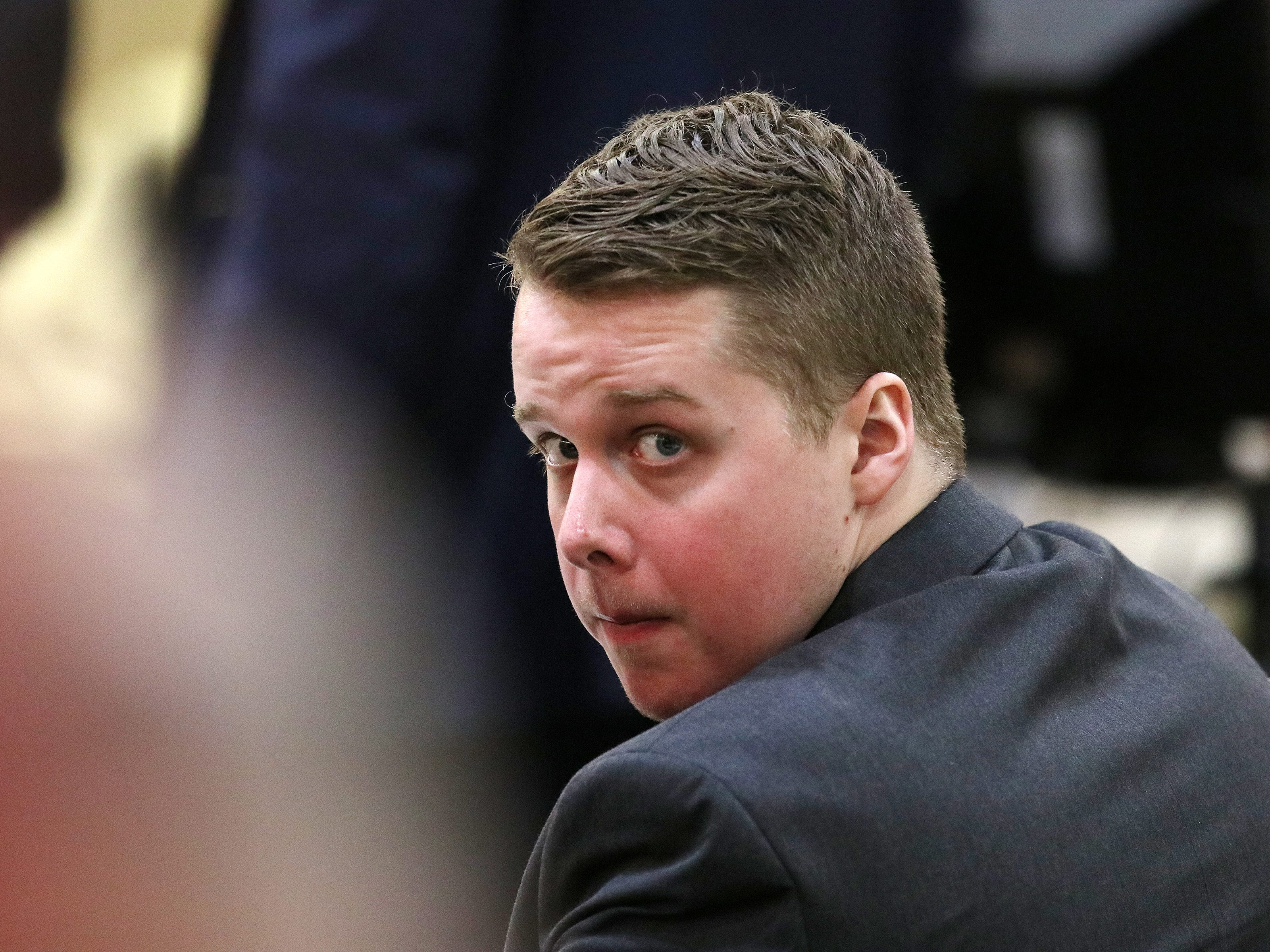 Liam McAtasney, who is charged with the murder of former high school classmate, Sarah Stern, looks back at his family during trial before Superior Court Judge Richard W. English at the Monmouth County Courthouse in Freehold, NJ Thursday, February 14, 2019.