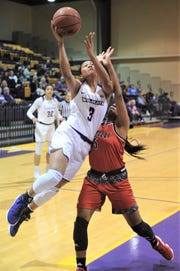 ACU's Dominique Golightly (3) drives to the basket while Nicholls' Airi Hamilton defends. The Wildcats beat Nicholls 76-66 in the Southland Conference game Wednesday, Feb. 13, 2019, at HSU's Mabee Complex.