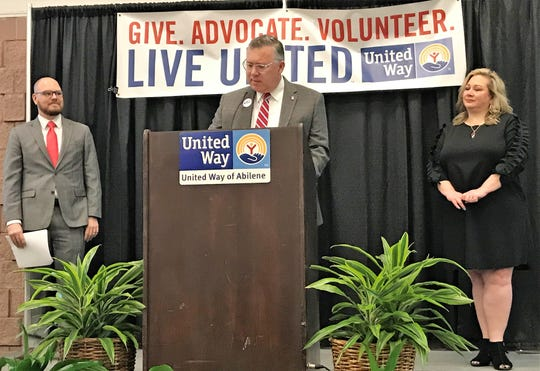 Bill Noonan, who co-chaired the 2019 United Way of Abilene campaign with his wife, Melissa, right, speaks Thursday at the organization's annual meeting. Evan Simmons, director of development, left, introduced the Noonans.