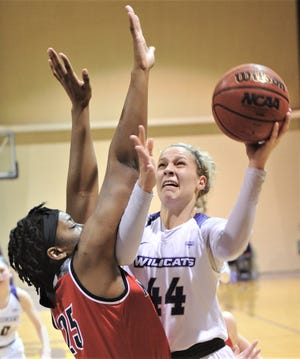 ACU's Lexie Ducat (44) shoots over Nicholls' Chrystal Ezechukwu (25) in the first half. The Wildcats beat Nicholls 76-66 in the Southland Conference game Feb. 13 at HSU's Mabee Complex.