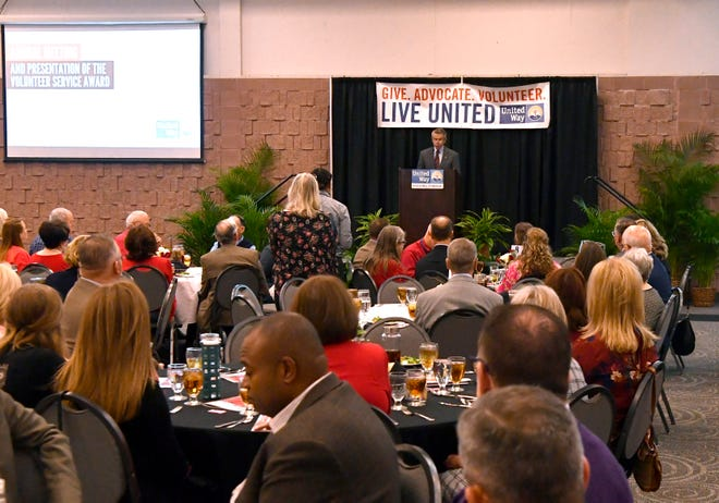 Larry Gill addresses the audience during the United Way of Abilene's annual luncheon Thursday. Gill was a member of the Dodge Jones Foundation team that last year was honored with the organization's top service award.