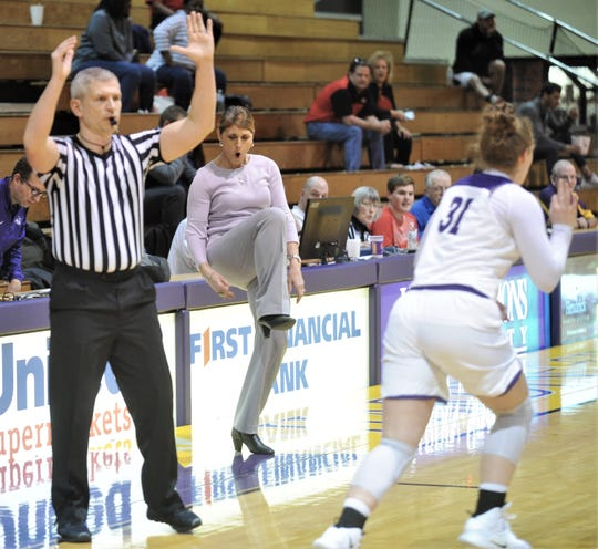 ACU coach Julie Goodenough, center, celebrates after one of her players hit a 3-point goal during the fourth quarter against Nicholls. The Wildcats beat Nicholls 76-66 in the Southland Conference game Wednesday, Feb. 13, 2019, at HSU's Mabee Complex.
