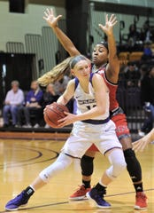 ACU's Breanna Wright, left, looks to pass the ball while being defended by a Nicholls player. The Wildcats beat Nicholls 76-66 in the Southland Conference game Wednesday, Feb. 13, 2019, at HSU's Mabee Complex.