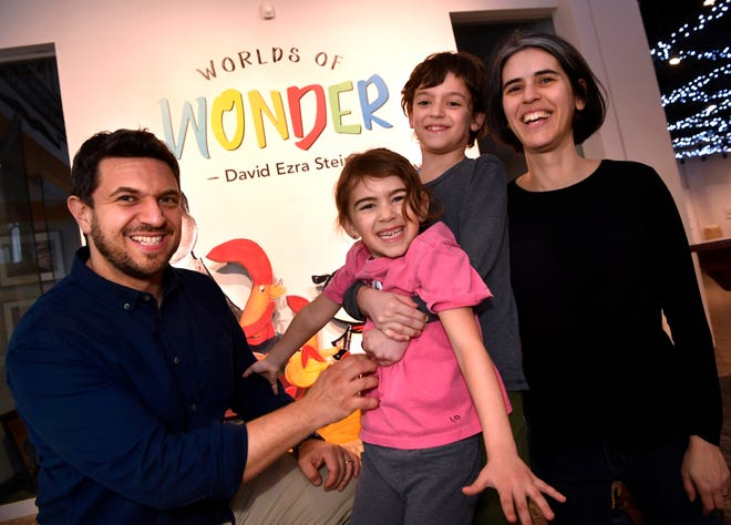 Author David Ezra Stein with his daughter Hannah 6, 9-year-old son Sam, and wife Miriam Kessler at the National Center for Children's Illustrated Literature after their arrival late Wednesday afternoon.