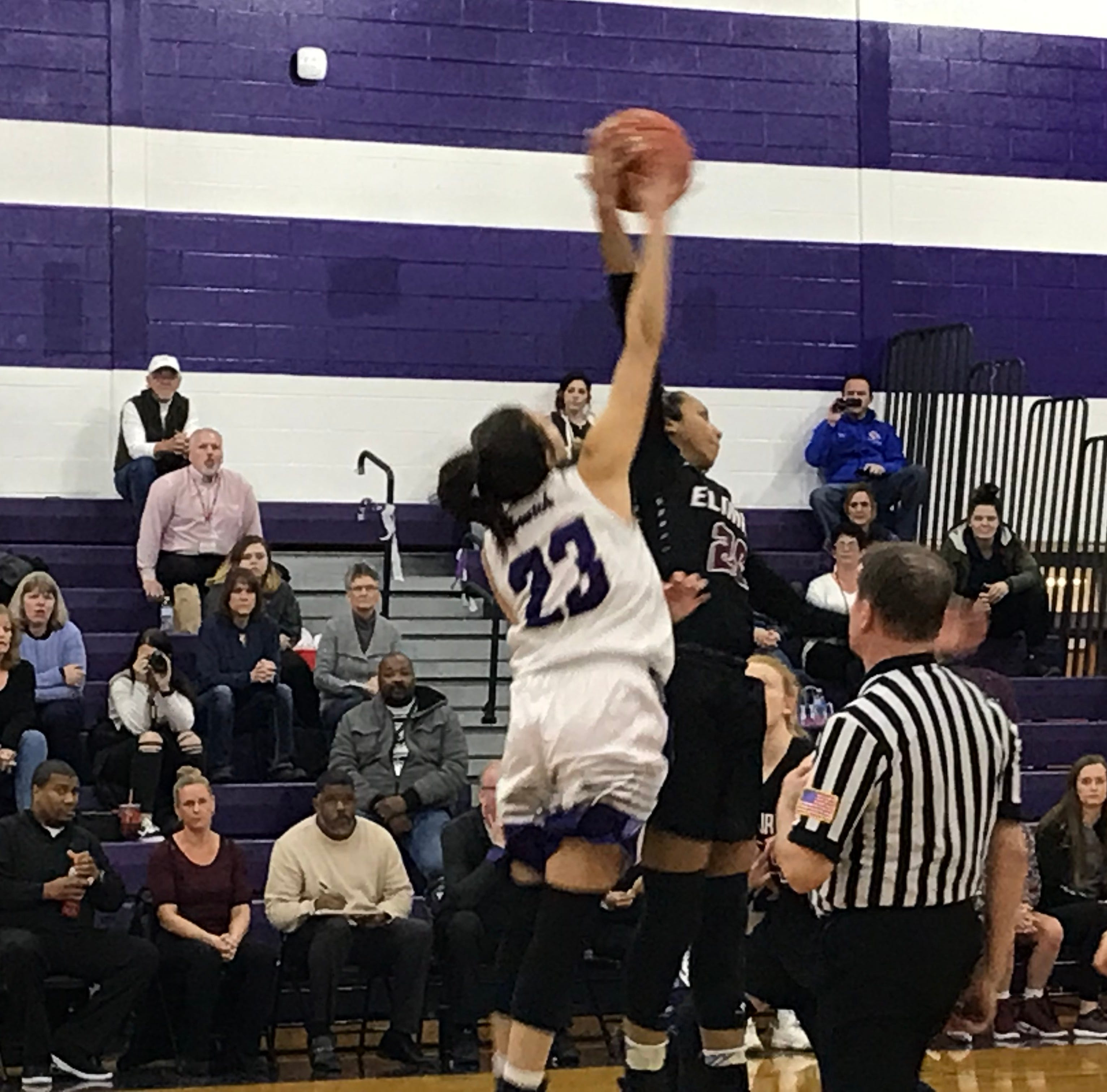 Elmira's Zaria DeMember-Shazer and Norwich's Saige Benedict compete for the opening tip in Wednesday's STAC semifinal at Norwich. The Purple Tornado won, 72-57.