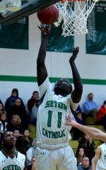 SCC's Mojo Ajak goes up for two against Elmira.