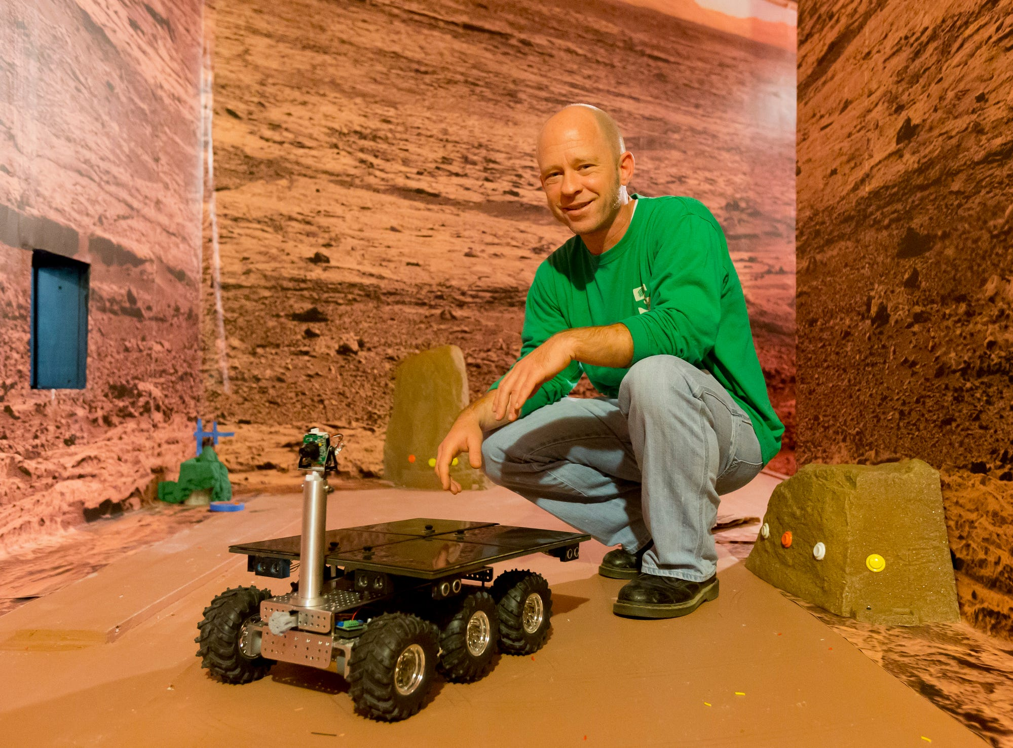Exhibit Developer David Jordan built a miniature remote control Mars Rover and simulated Martian environment at the Sciencenter in Ithaca in 2014.