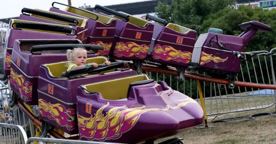 Belladonna Kindt, 3, takes in a ride during the Kitsap County Fair & Stampede in August.