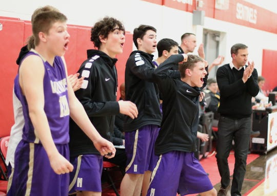North Kitsap's bench celebrates in the closing moments of Wednesday's 52-39 victory over Steilacoom in Class 2A district tournament play. With the win, North Kitsap qualified for the regional round of the state tournament.