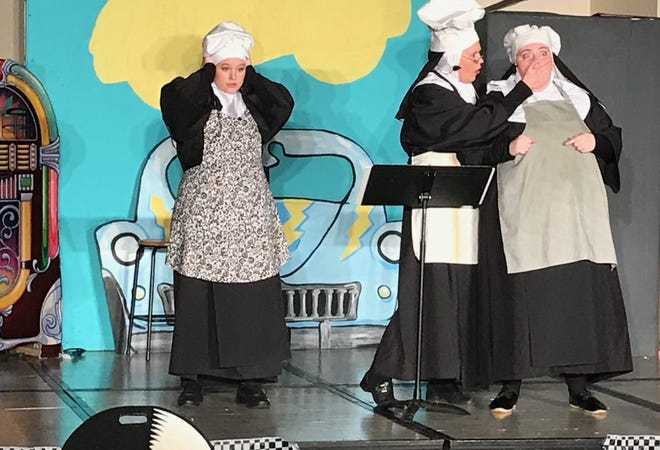 The Reverend Mother (Judy Batschi, middle) has some shocking news for Amnesia (Hannah Robinson, left) and Hubert (Amy Knickerbocker).