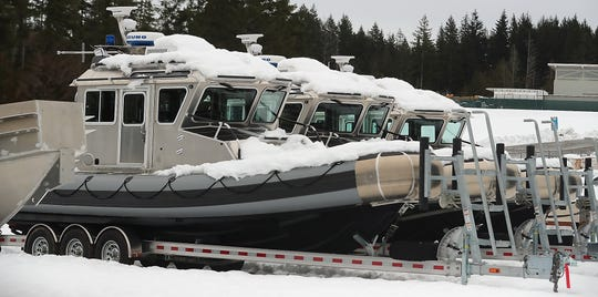 A trio of boats await finishing in the yard at SAFE boats in Bremerton on Thursday, February 14, 2019.
