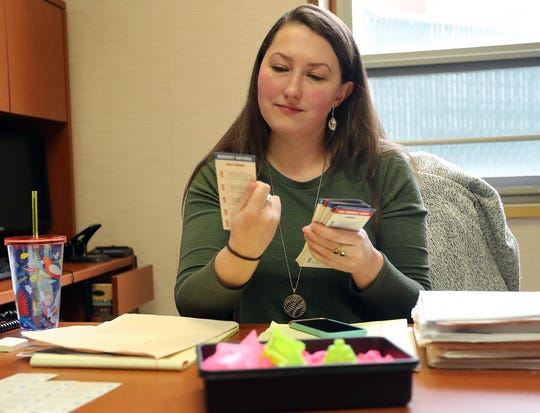 Kitsap County Public Defender Laura Schulman looks over a couple of cards from an old Jeopardy! board game that she has been using to practice for her upcoming appearance as a contestant on Jeopardy! in her office at the Kitsap county Courthouse on Wednesday, February 13, 2019.