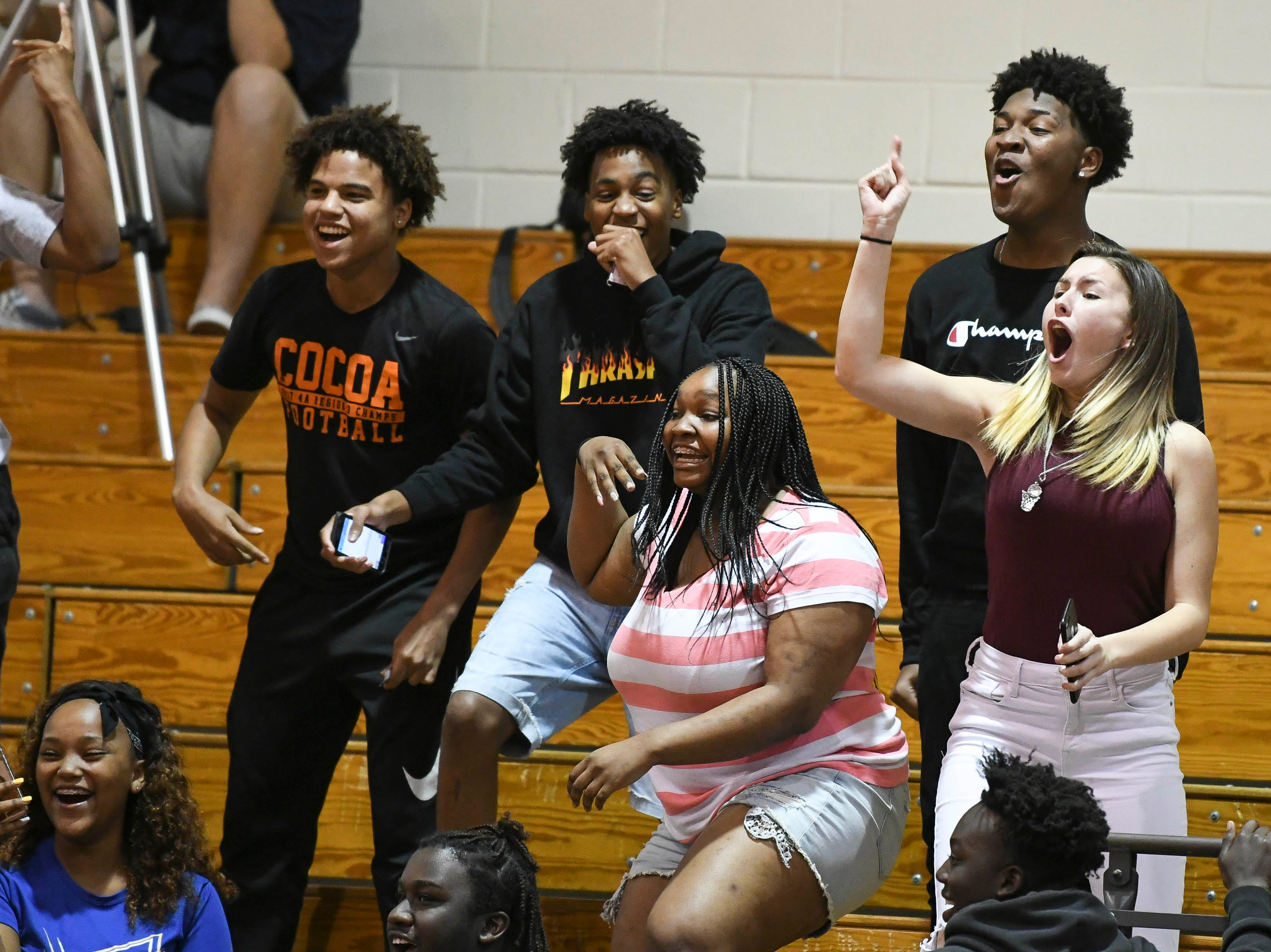 Fans cheer during Tuesday's District 14-6A boys basketball tournament game between Titusville and Merritt Island.