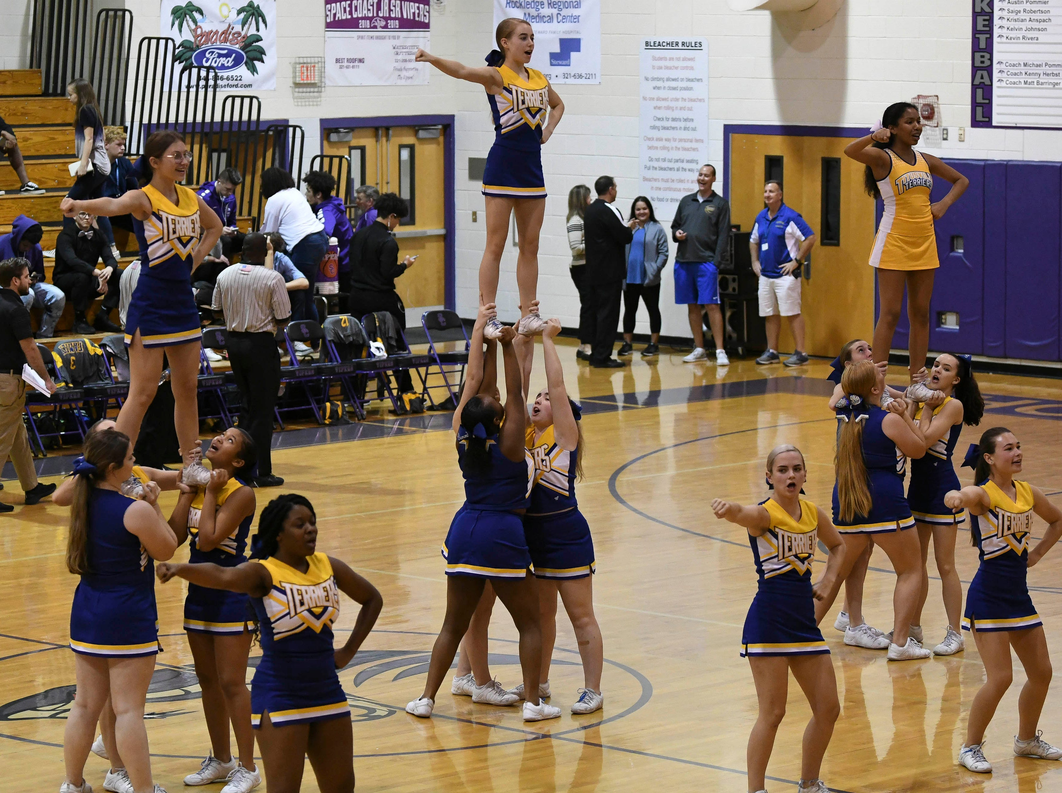 Titusville cheerleaders perform during Tuesday's District 14-6A boys basketball tournament at Space Coast Jr/Sr High.