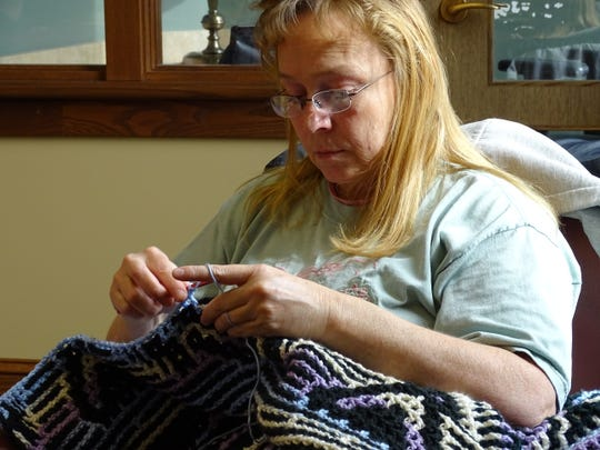 Candi Kuhn knits during a Sit and Stitch program on Thursday at the Bucyrus Public Library.