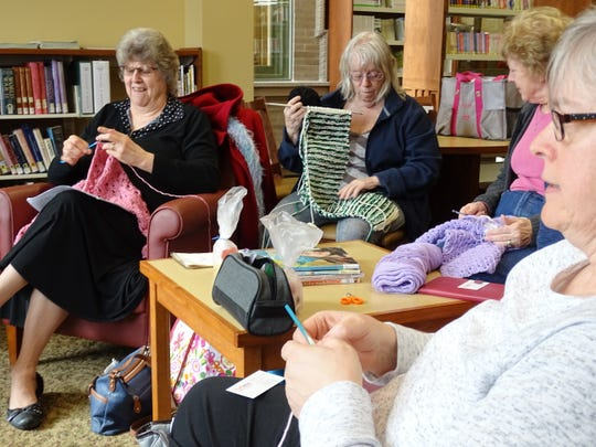 Cindy Wert, Julie Polak, Cathy Bloomfield and CVirginia Michalek, from left, work on projects during a Sit and Stitch program on Thursday at the Bucyrus Public Library.