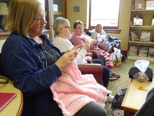 Cheryl Luidhardt, Virginia Michalek, Katie Smith and Candi Kuhn, from left, work on projects during a Sit and Stitch program on Thursday at the Bucyrus Public Library.