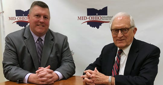 Kevin Kimmel, left, was selected as the new superintendent of the Mid-Ohio Educational Service Center on Wednesday. At right is MOESC's interim superintendent, Ed Swartz.