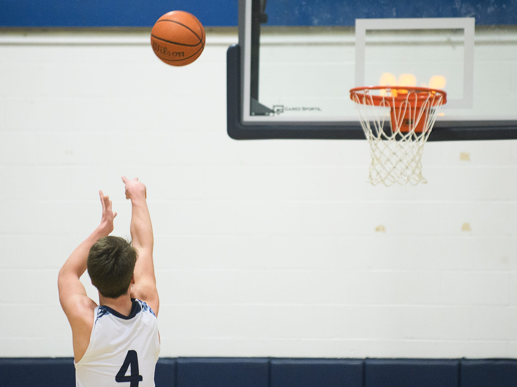 MMU's Harrison Leombruno-Nicholson (4) shoots a free throw during the boys basketball game between the Essex Hornets and the Mount Mansfield Cougars at MMU High School on Wednesday night February 13, 2019 in Jericho, Vermont.
