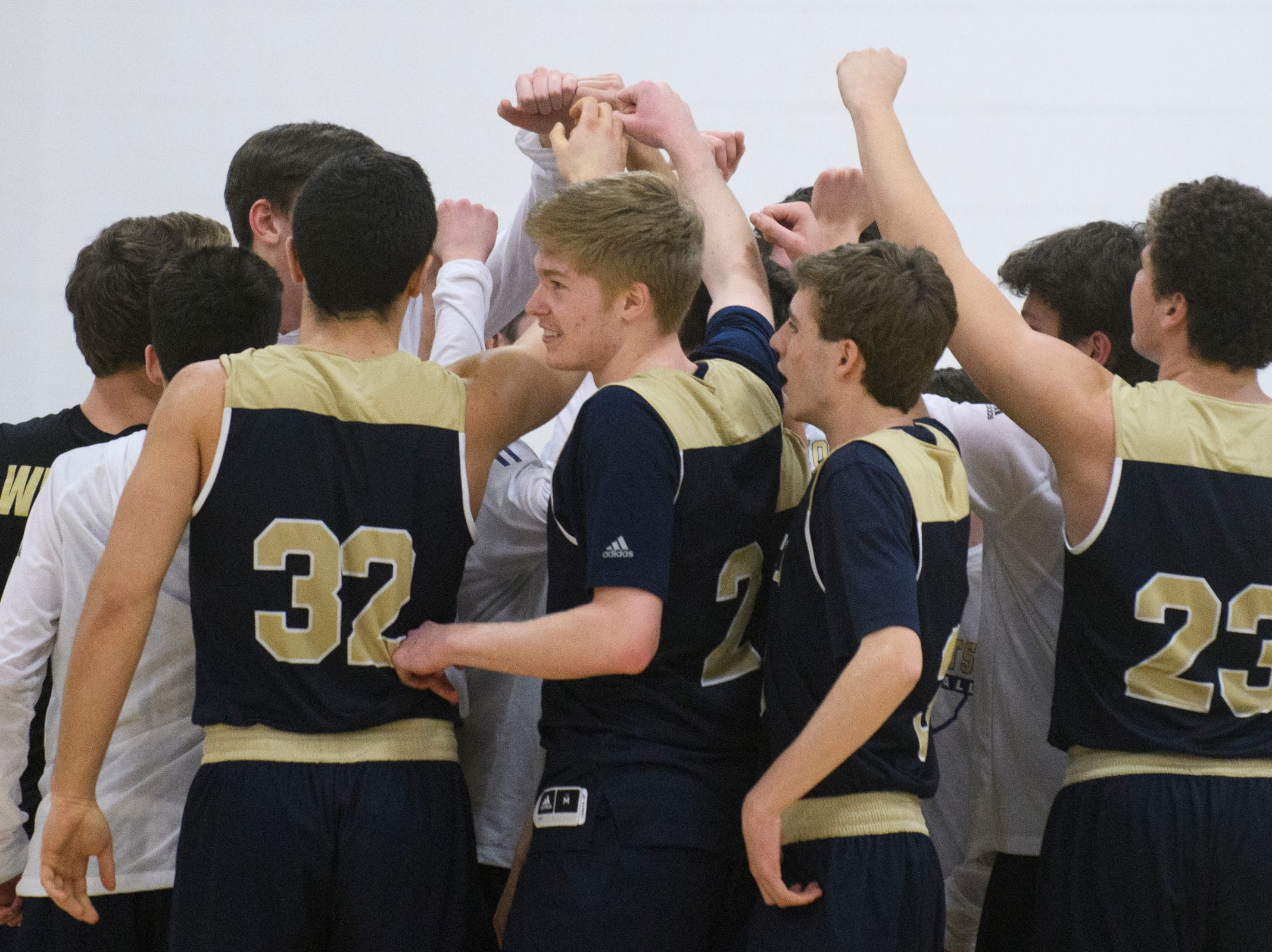 Essex huddles together during the boys basketball game between the Essex Hornets and the Mount Mansfield Cougars at MMU High School on Wednesday night February 13, 2019 in Jericho, Vermont.