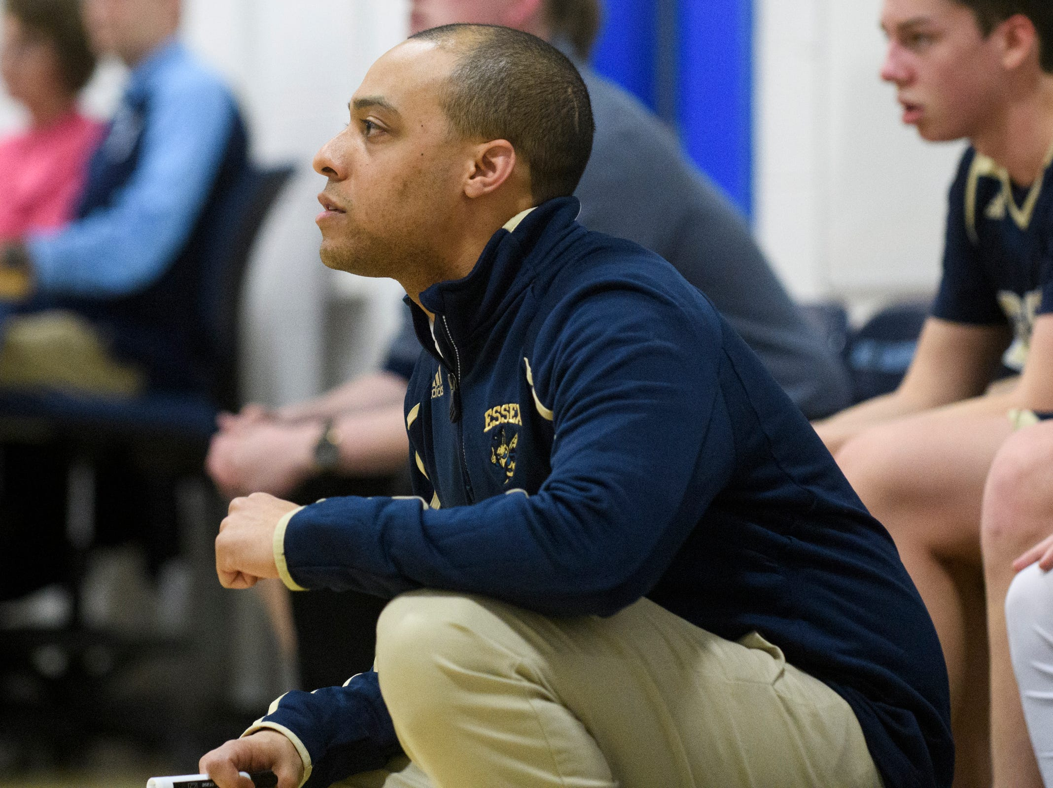 Essex head coach Jesse Coutrayer watches the action on the court during the boys basketball game between the Essex Hornets and the Mount Mansfield Cougars at MMU High School on Wednesday night February 13, 2019 in Jericho, Vermont.