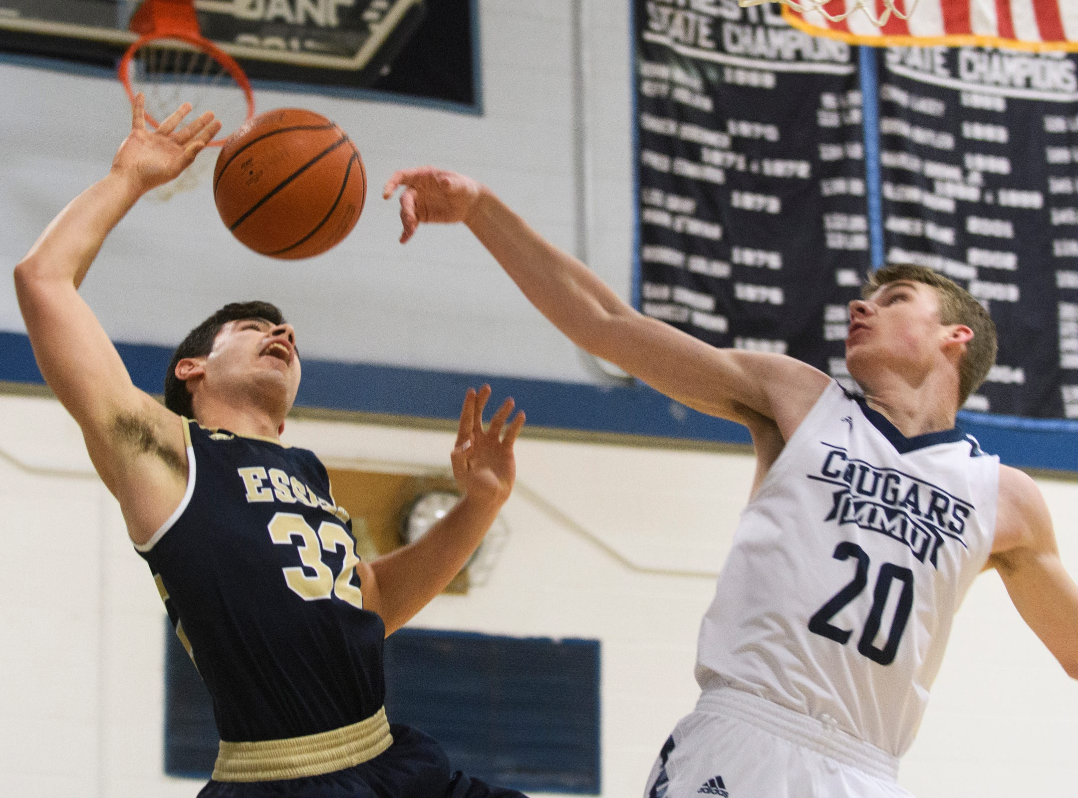 MMU's Connor Philbrick (20) blocks the shot by Essex's Adin Peco (32) during the boys basketball game between the Essex Hornets and the Mount Mansfield Cougars at MMU High School on Wednesday night February 13, 2019 in Jericho, Vermont.