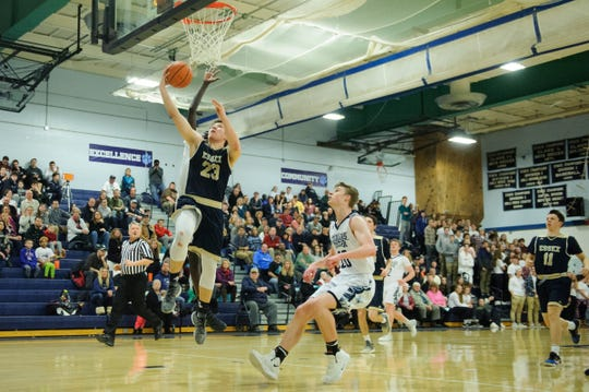 Essex's Anthony Decaravalho (23) leaps for a lay up during the boys basketball game between the Essex Hornets and the Mount Mansfield Cougars at MMU High School on Wednesday night February 13, 2019 in Jericho, Vermont.