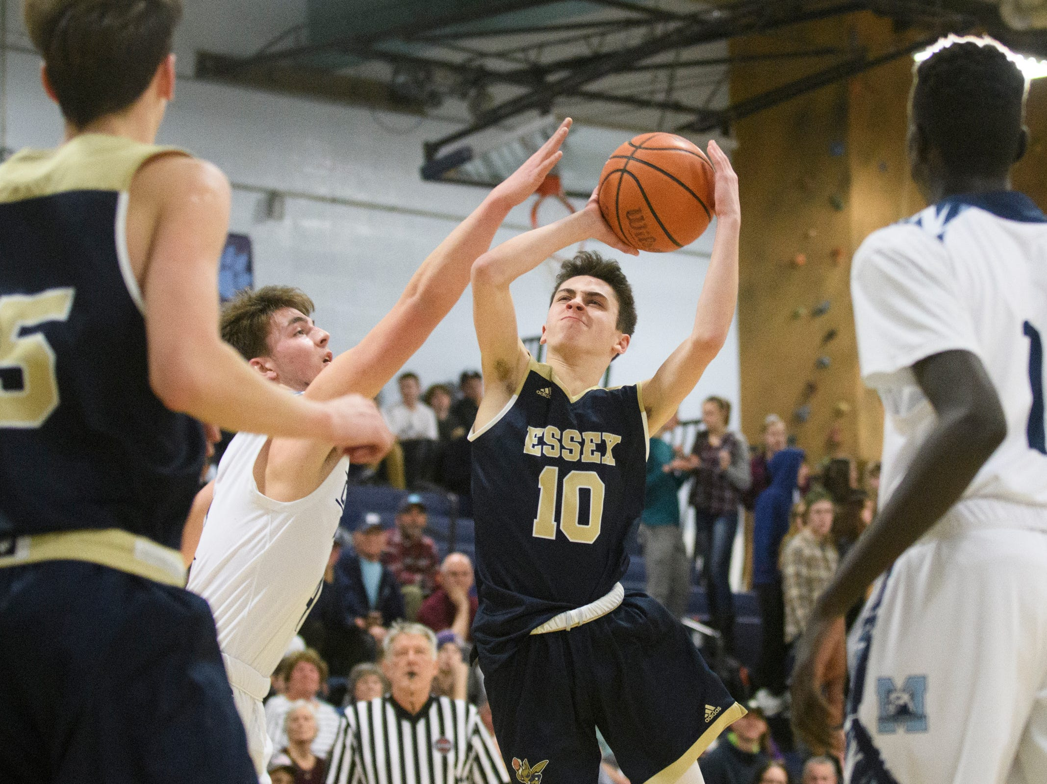 Essex's Aiden Paquette (10) leaps to take a shot during the boys basketball game between the Essex Hornets and the Mount Mansfield Cougars at MMU High School on Wednesday night February 13, 2019 in Jericho, Vermont.